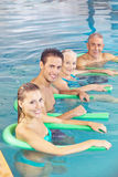 People doing aqua fitness as back. Training in a swimming pool Royalty Free Stock Image