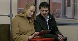 People Doing Business on the Way with Tablet PC. Business people are working using tablet PC while riding a metro stock video footage