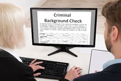 People Doing Criminal Background Check royalty free stock photo