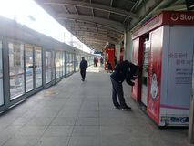 People doing different activities at subway station Stock Photo