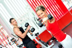 People doing exercises in the gym Stock Images