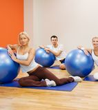 People doing fitness exercise. Group of people doing fitness exercise with a ball Stock Photo