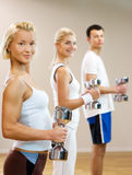 People doing fitness exercise Stock Photos