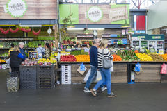 People doing grocery shopping in a market in Melbourne Stock Image