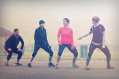 People doing keep fit exercise in park stock photos