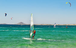 People doing kitesurf and windsurf at Naxos island Cyclades Greece Royalty Free Stock Images