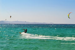 People doing kitesurf and windsurf at Naxos island Cyclades Greece Royalty Free Stock Photo