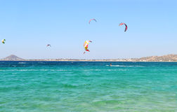 People doing kitesurf and windsurf at Naxos island Cyclades Greece royalty free stock photography