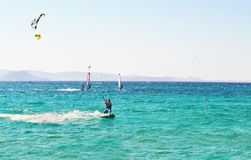People doing kitesurf and windsurf at Naxos island Cyclades Greece royalty free stock image