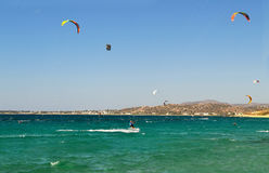 People doing kitesurf and windsurf at Naxos island Cyclades Greece royalty free stock photos