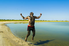 People are doing mud therapy. People make mud therapy and are very happy Royalty Free Stock Image