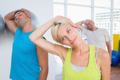 People doing neck exercise in fitness club Royalty Free Stock Image