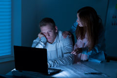 People doing overtime at night Royalty Free Stock Image