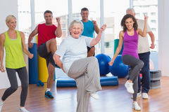 People doing power fitness exercise at fitness studio Royalty Free Stock Photography