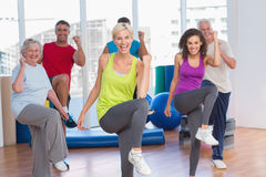 People doing power fitness exercise at fitness studio Royalty Free Stock Image