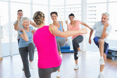 People doing power fitness exercise at yoga class in fitness studio Royalty Free Stock Photos