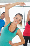 People doing power fitness exercise at yoga class Stock Photography