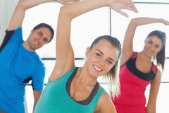 People doing power fitness exercise at yoga class Stock Photo