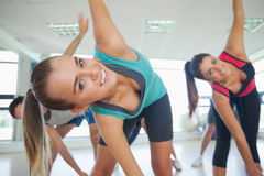 People doing power fitness exercise at yoga class Stock Image