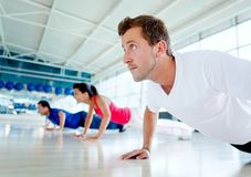 People doing push ups Royalty Free Stock Photo