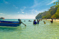 People doing snorkling. Tourist on a colorful beach of Thailand doing water sport activity Stock Photos