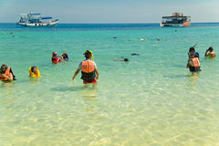 People doing snorkling. Tourist on a colorful beach of Thailand doing water sport activity Stock Images