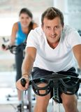 People doing spinning at the gym Stock Image