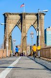People doing sport on the Brooklyn Bridge, NYC, USA. People doing sport in the morning on the Brooklyn Bridge, NYC, USA royalty free stock images
