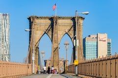 People doing sport on the Brooklyn Bridge, NYC, USA. People doing sport in the morning on the Brooklyn Bridge, NYC, USA stock photo