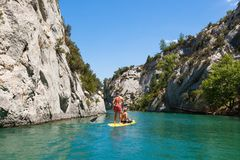 People doing standing paddle in  Gorge du Verdon canyon river in. South of France Royalty Free Stock Photos