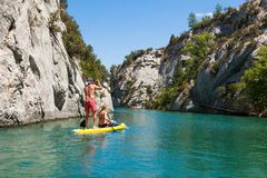 People doing standing paddle in  Gorge du Verdon canyon river in. South of France Royalty Free Stock Images