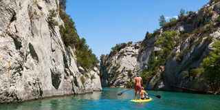 People doing standing paddle in  Gorge du Verdon canyon river in. South of France Stock Photos