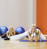 People doing stretching exercise royalty free stock photos