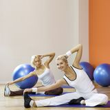 People doing stretching exercise stock photos