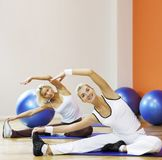 People doing stretching exercise Royalty Free Stock Photography