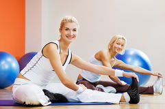 People doing stretching exercise Royalty Free Stock Photo