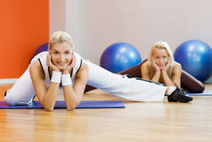 People doing stretching exercise Royalty Free Stock Image