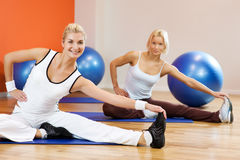 People doing stretching exercise Stock Image