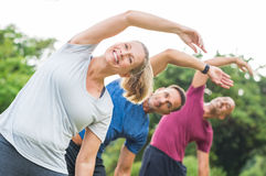 People doing stretching exercise stock photography