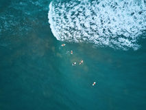People doing surf. In blue ocean water aerial above view Royalty Free Stock Photos