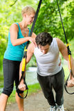 People doing suspension or sling trainer fitness Stock Images