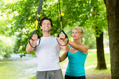 People doing suspension or sling trainer fitness Royalty Free Stock Image