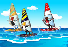 People doing windsurfing in the sea Royalty Free Stock Images