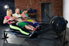 People is doing workout on the rowing machines royalty free stock images