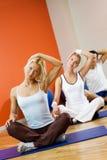 People doing yoga exercise Stock Photography