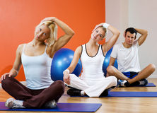People doing yoga exercise Stock Photo