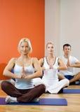 People doing yoga exercise Stock Image
