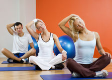 People doing yoga exercise Royalty Free Stock Image