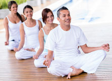People doing yoga Stock Images