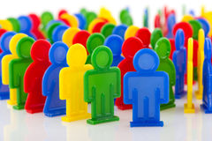People in domino effect. A circle of colorful people in domino effect Stock Photo